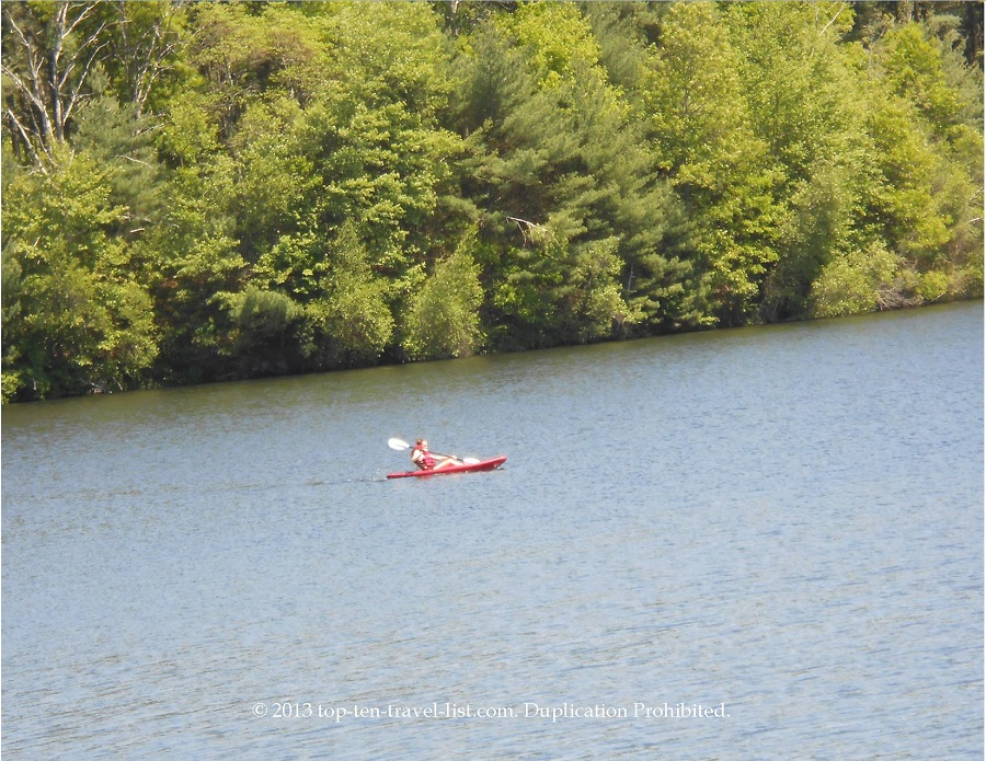 View of a kayaker on Lake Rico, Massasoit State Park - East Taunton, MA