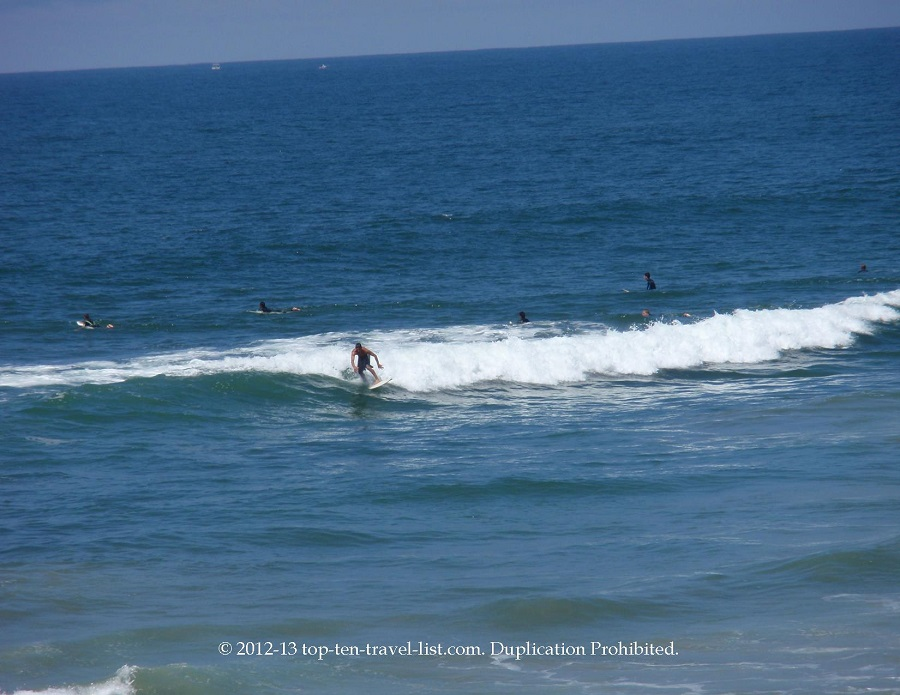 Surfers in Huntington Beach, California