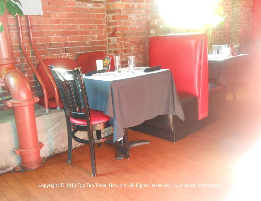 Seating area and exposed brick at Bella Luna in Jamaica Plain, MA