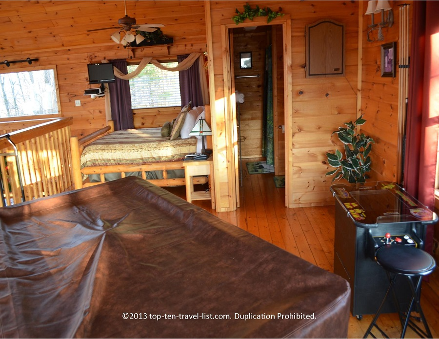 Pool table and arcade in Life's a Bear Gatlinburg cabin rental