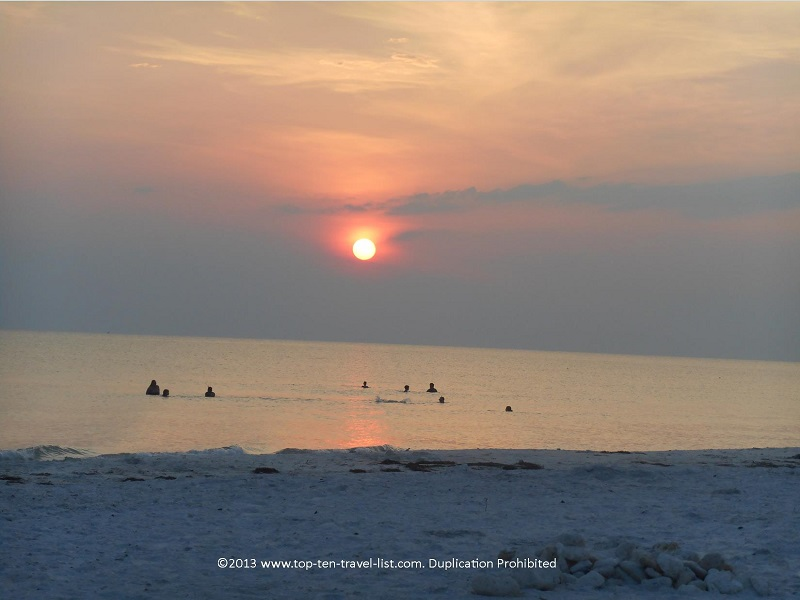 People swimming in the sunset - Honeymoon Island - Dunedin, Florida