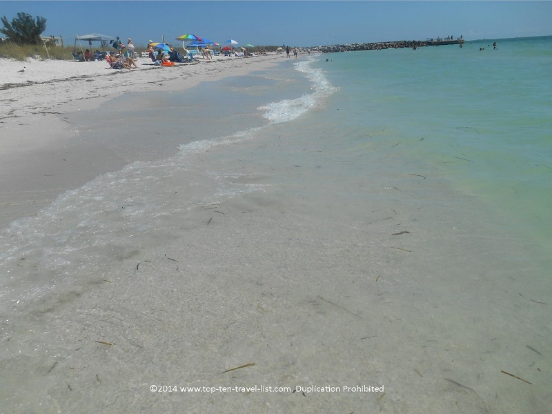 Walking along the clear water at Pass-A-Grille Beach in St. Petersburg, Florida