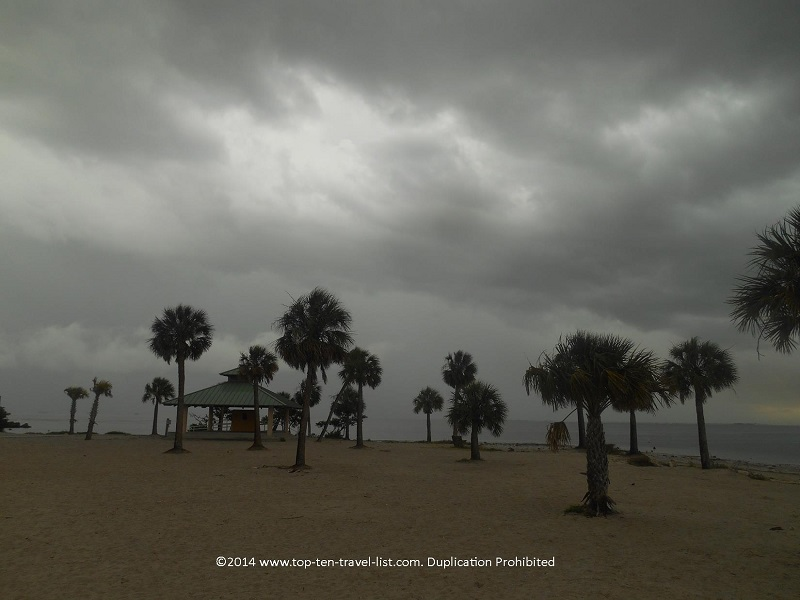 Dark clouds and lots of palm trees - Sunset Beach in Tarpon Springs, Florida