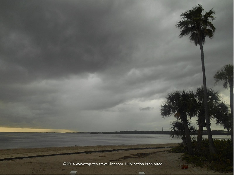 Dark storm clouds and palm trees at Sunset Beach in Tarpon Springs, Florida