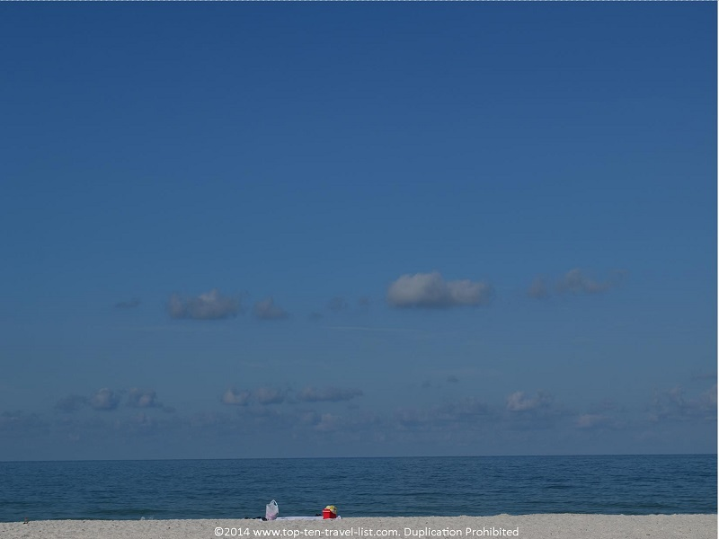 Blue skies and clear water at St. Pete Municipal Beach in Treasure Island, Florida