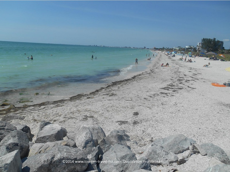 Seashell collecting by the jetty at Pass-A-Grille Beach in St. Petersburg, Florida