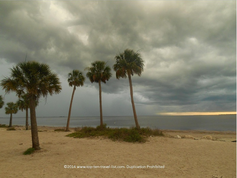 The sun peeking in through the storm clouds at Sunset Beach in Tarpon Springs, Florida