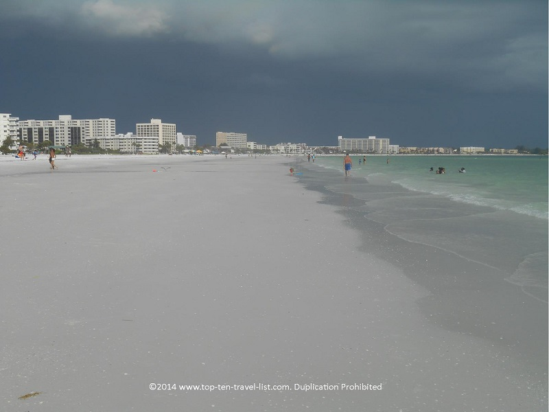 A view down Sarasota's Siesta Key Beach on a stormy day