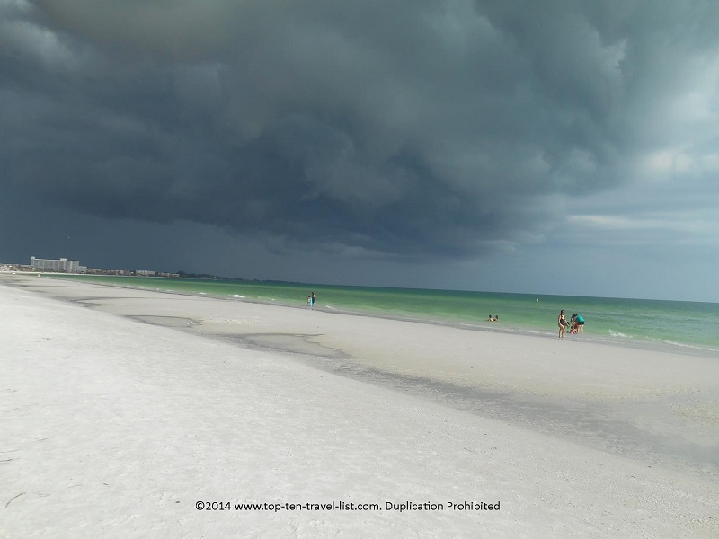 Dark storm clouds and greenish looking water on Sarasota's Siesta Key Beach