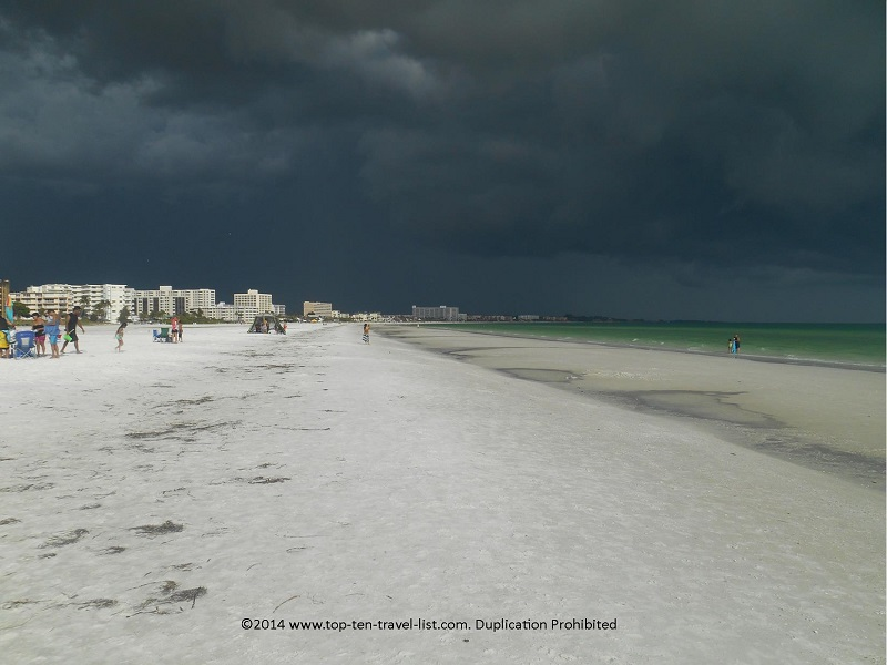 Dark storm clouds making the water appear green at Sarasota's Siesta Key Beach