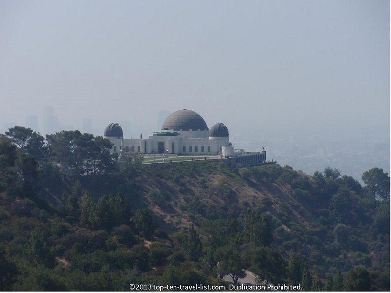View of the observatory and city from the Griffith Observatory hiking trail - Los Angeles, California