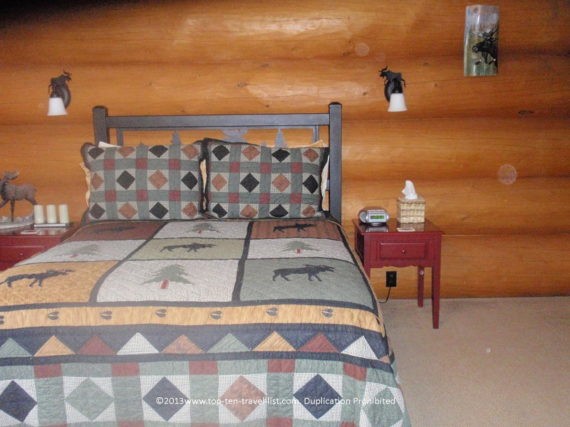 A rustic moose themed bedroom at the Bear Mountain Lodge in the White Mountains of New Hampshire