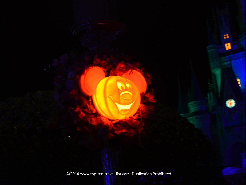 Mickey Halloween wreaths lit up at night - Mickey's Not So Scary Halloween Party at the Magic Kingdom