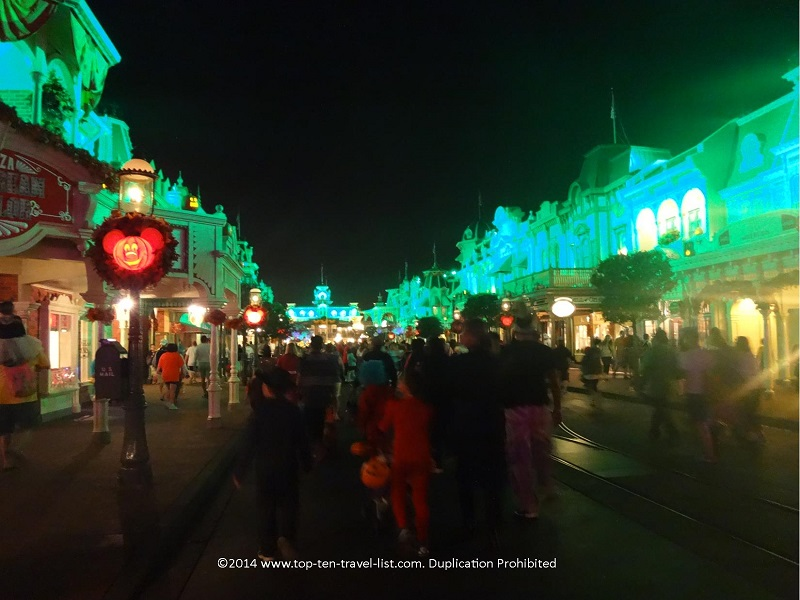 Main Street lit up green for Mickey's Not So Scary Halloween Party at the Magic Kingdom