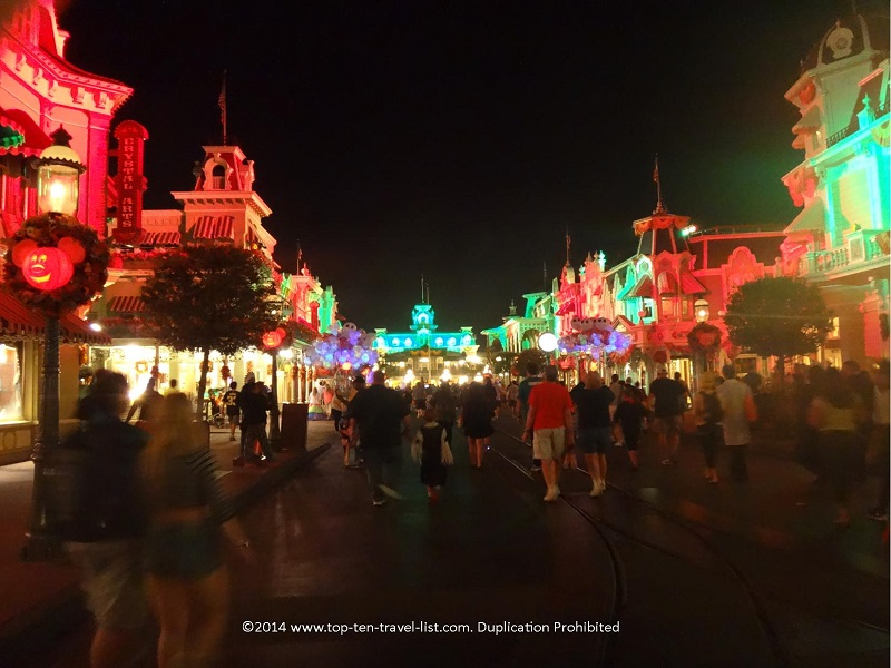Main Street lit up orange and green for Mickey's Not So Scary Halloween Party at the Magic Kingdom