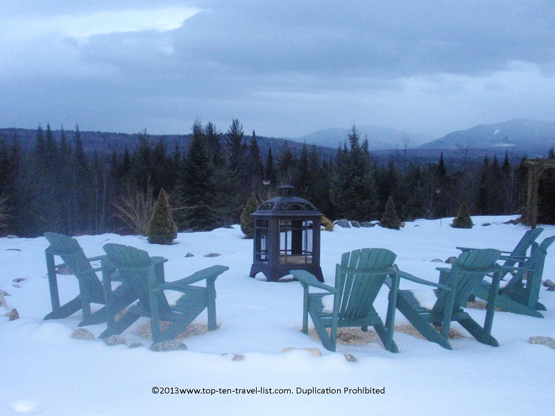 Snowy outdoor fire pit at Bear Mountain Lodge in New Hampshire