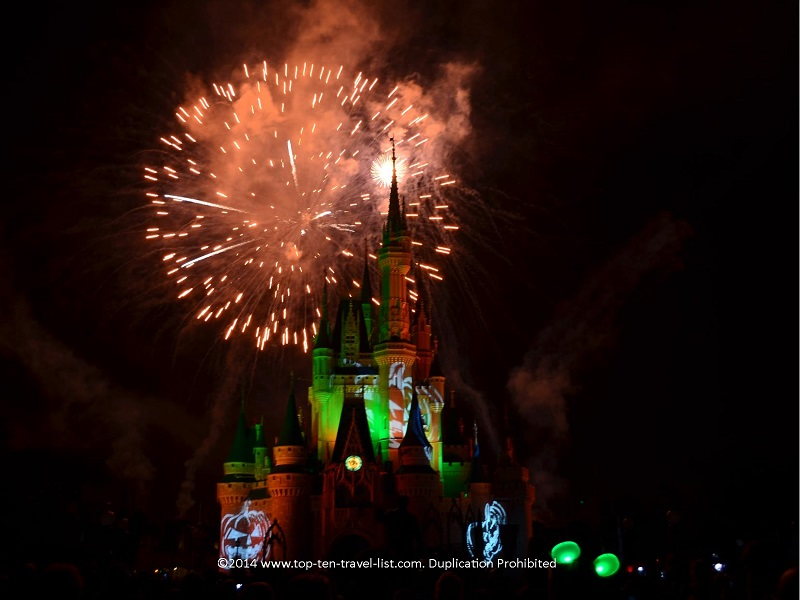 Pumpkin projections during the festive Hallowishes at Magic Kingdom