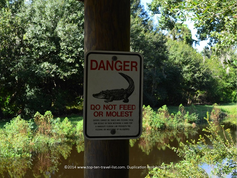 Danger alligator sign at Sawgrass Lake Park in St. Petersburg, Florida
