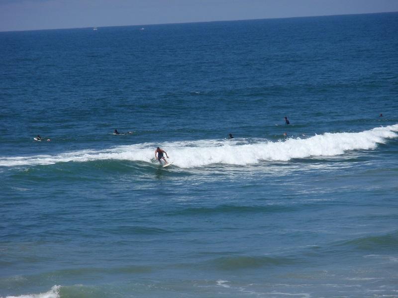 Surfers in Huntington Beach, California