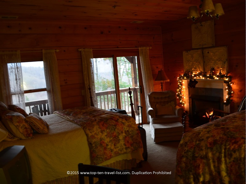 One of the charming Lazy Bear guest rooms, complete with a fireplace and great mountain views!