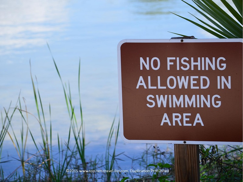 Swimming sign at Lake Osprey at Oscar Scherer State Park in Osprey, Florida