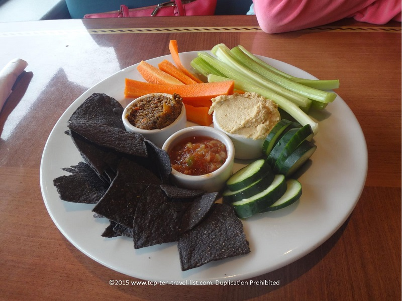 The hummus plate appetizer, served with 3 dipping sauces, blue corn chips, and sliced veggies. Excellent!