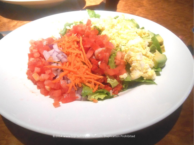The humongous Cobb Salad can easily be made vegetarian or gluten-free! Sub with avocado or extra veggies!