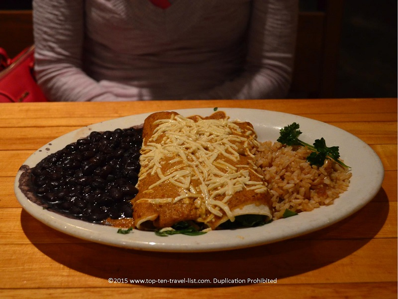 The Spinach Mushroom Enchiladas (stuffed with sauteed mushrooms, spinach, and red onions) and topped with your choice of sauce and regular or dairy cheese is the perfect option for anyone craving a little bit of spiciness but not over the top. This fantastic dish is available gluten-free and is served alongside rice and black beans.