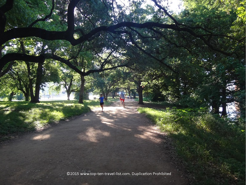 Runners and bikers on Austin's beautiful Lady Bird Lake trail