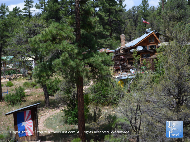 A house out in the pines seen from the Grand Canyon Railway