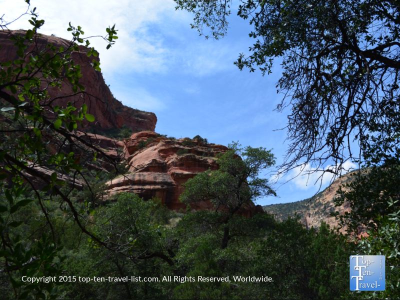 Beautiful trees and red rock lines the Fay Canyon hiking trail in Sedona, Arizona