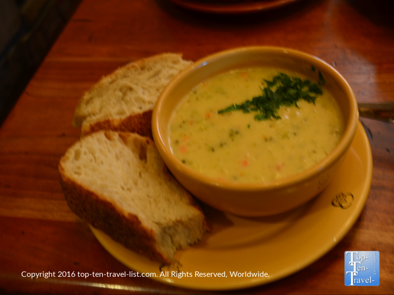 Delicious broccoli cheese soup with a side of whole grain bread at Wildflower.