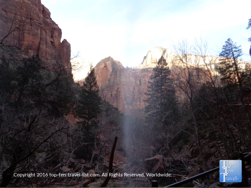 Standing under the waterfall on theLower Emerald Pools trail at Zion National Park