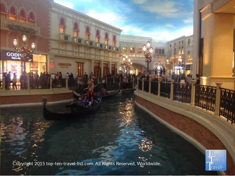 If you feel the need to visit a shopping area, The Venetian's Grand Canal Shoppes offers the most beautiful setting. As you stroll around, you can watch the gondolas and take in all the pretty decor and window shop at some of the country's most luxurious retailers.