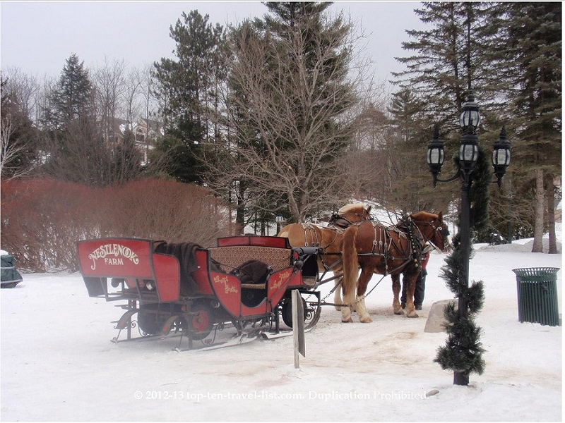 A romantic horse drawn sleigh ride at Nestlenook Farms in Jackson, New Hampshire