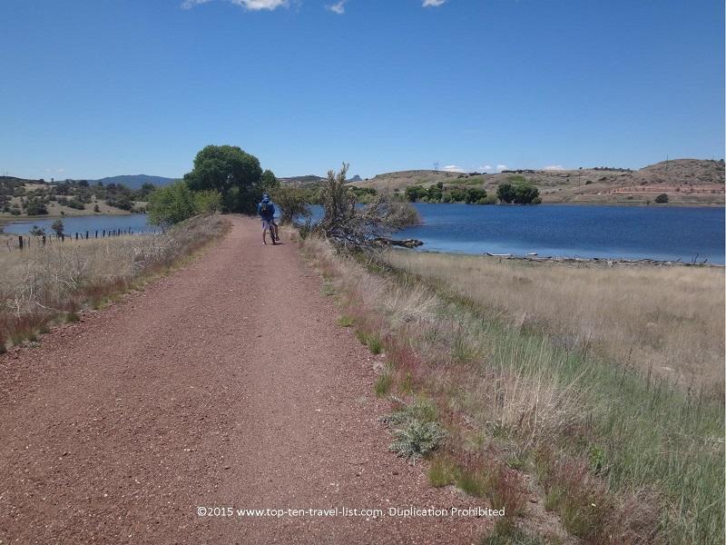 Biking along the gorgeous Peavine National Recreational Trail with beautiful views of Watson Lake.