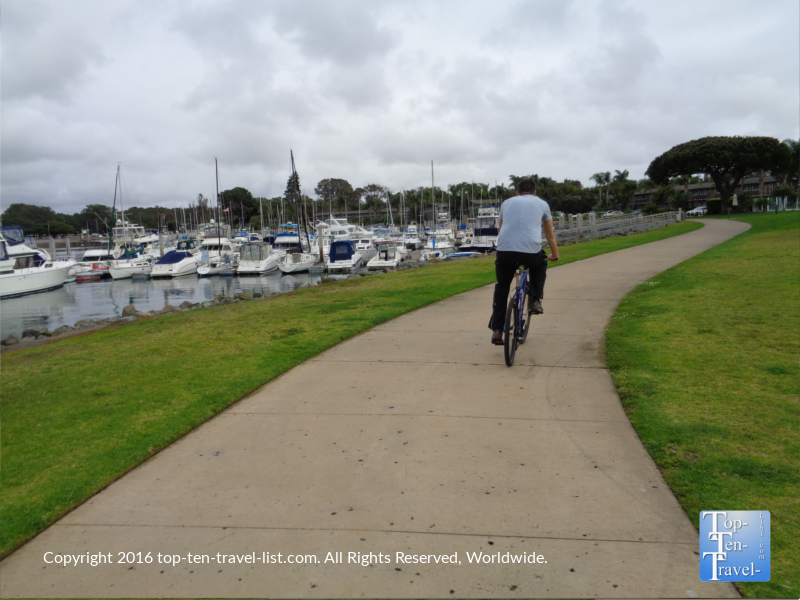 Biking past Crown Point Park on the Mission Bay bike path in San Diego