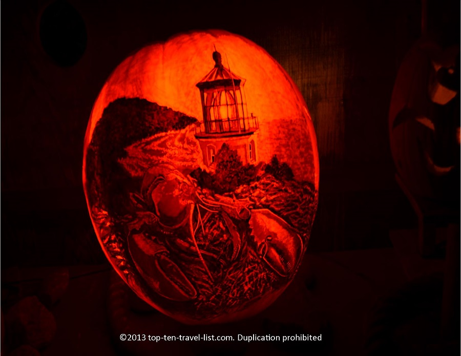 Check out the incredible detail on this carving! A beautiful lighthouse and lobster representing Maine.