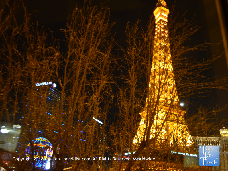 The Eiffel Tower lit up at night as seen from the Paris Las Vegas hotel