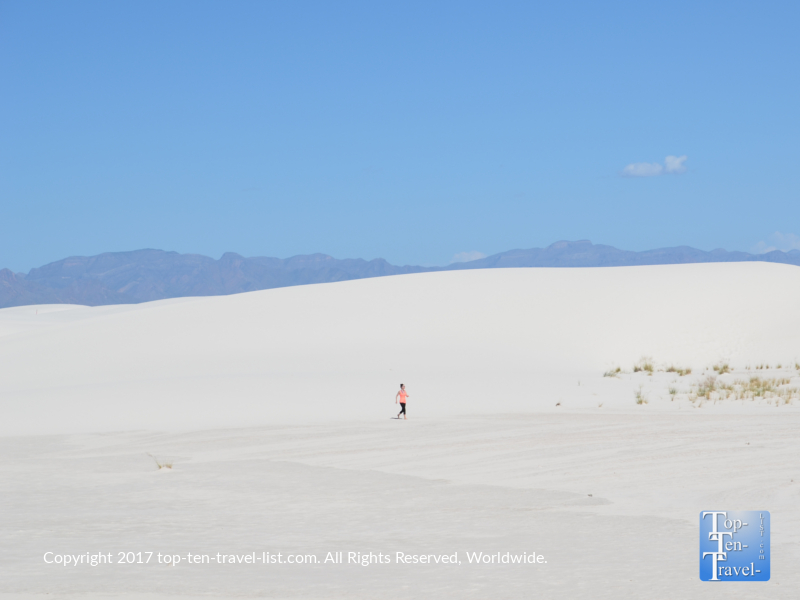 Walking barefoot across the soft gypsum sand dunes at White Sands National Monument in New Mexico
