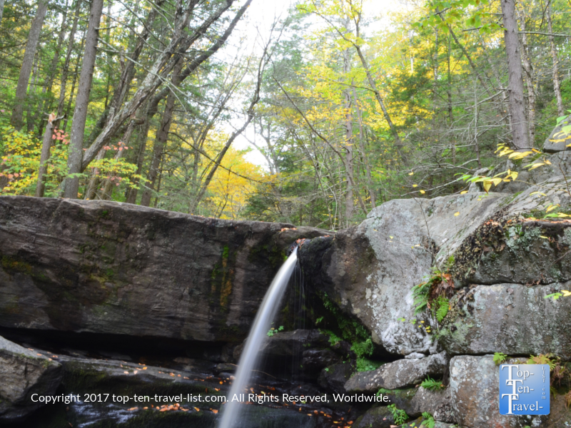 Pretty waterfall and fall foliage at Enders Falls in Granby, Connecticut