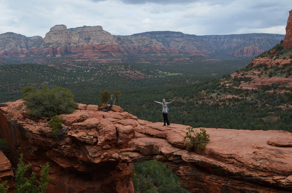 Walking across Devil's Bridge arch in Sedona, Arizona