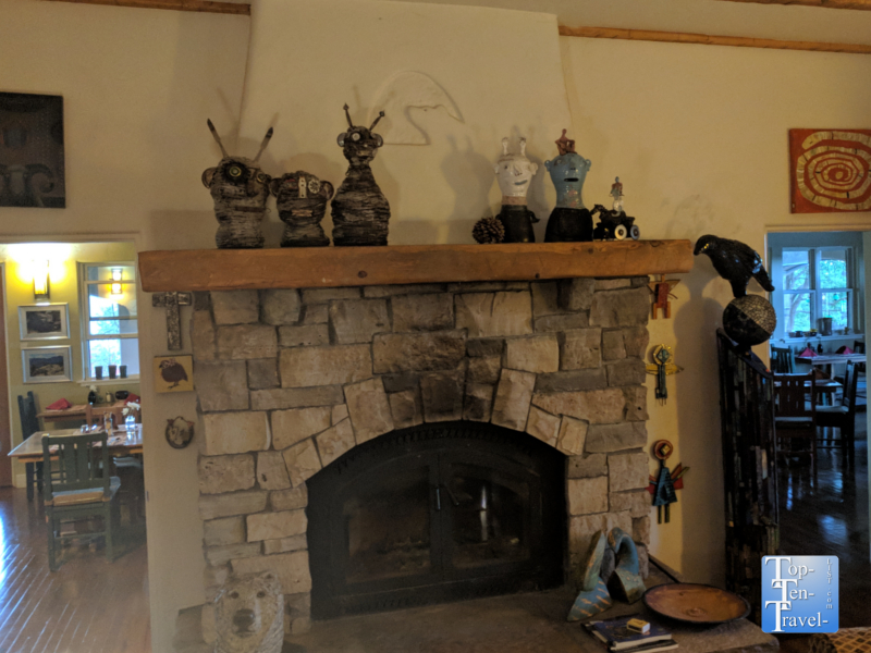 Rustic fireplace and beautiful art work at the Bear Mountain Lodge in Silver City, New Mexico