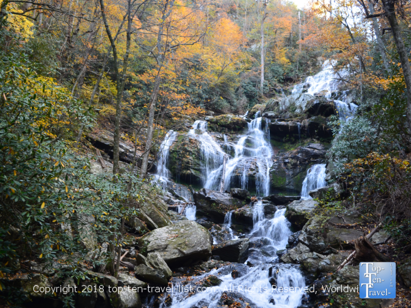 Fall colors surrounding the beautiful Catawba falls waterfall in North Carolina