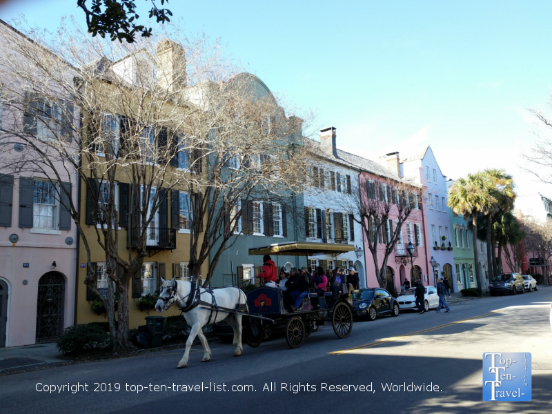 Horse drawn carriage making its' way down historic Rainbow Row in Charleston, South Carolina
