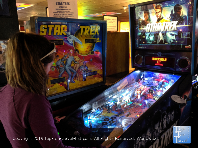 Playing a Star Trek pinball machine at the Asheville Pinball Museum