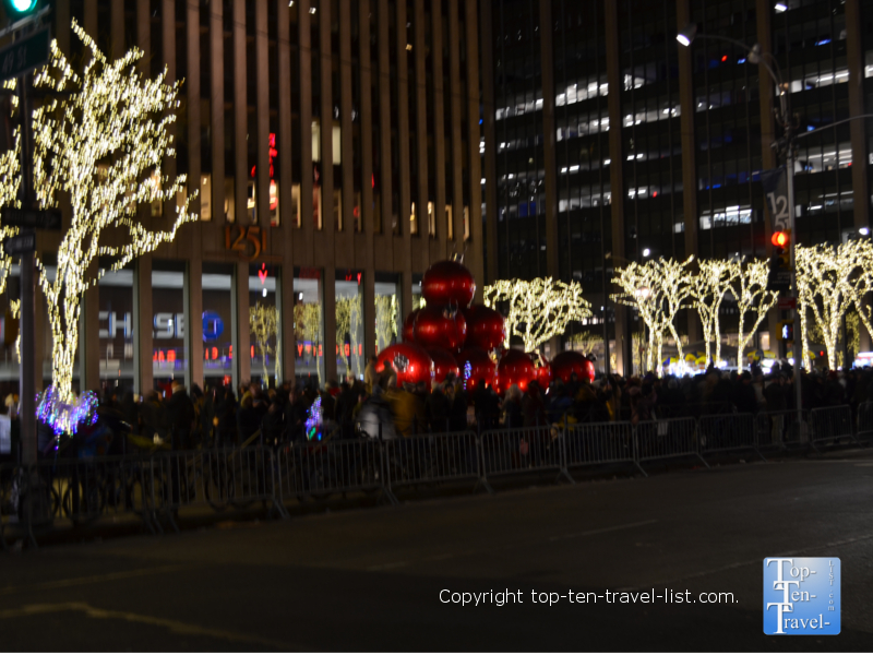 Festive giant red ornaments at 6th Avenue in NYC