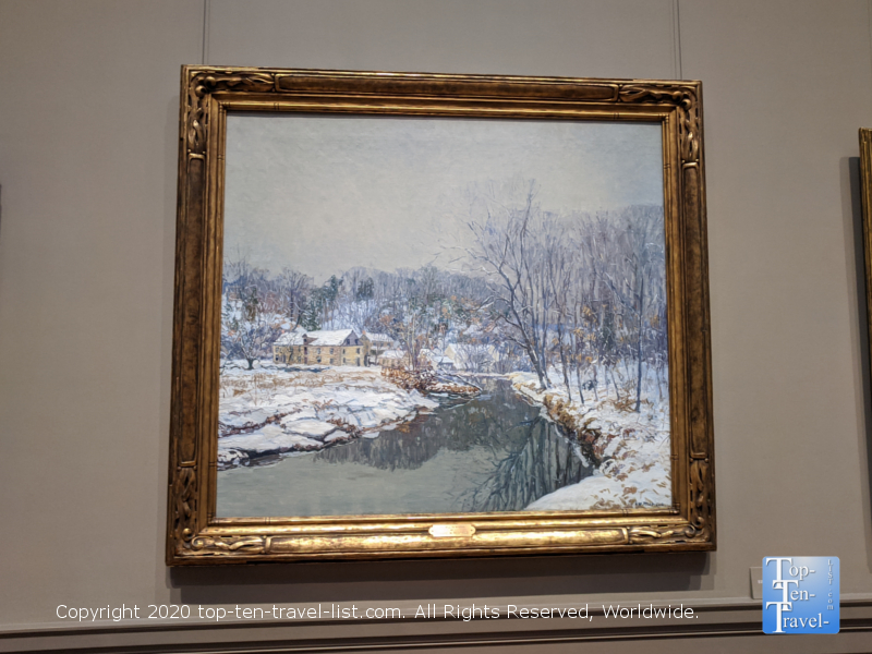 Beautiful winter scene painting at the National Gallery of Art west building in Washington D.C.