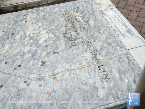 Pennies on Benjamin Franklin's grave in Old City Philadelphia