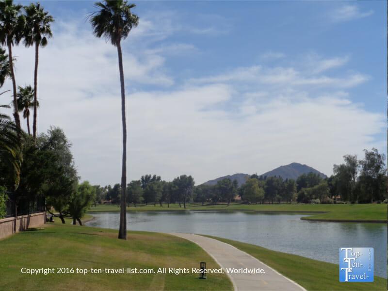 Lush greenery and mountain views along the Indian Bend bike path in Scottsdale, Arizona
